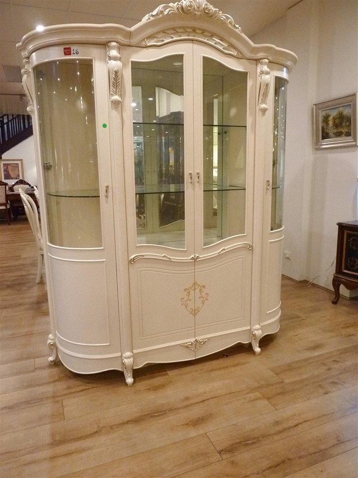 Four Door Display Cabinet In An Antique White French Provincial