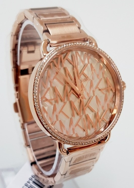 Ladies new Michael Kors NY Couture beautiful 'MK' rose gold watch.