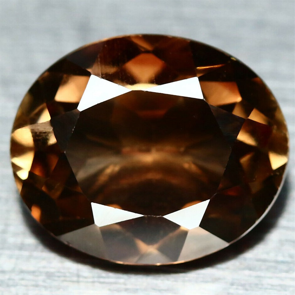 4.96 ct. Oval Facet Cut Champagne Topaz