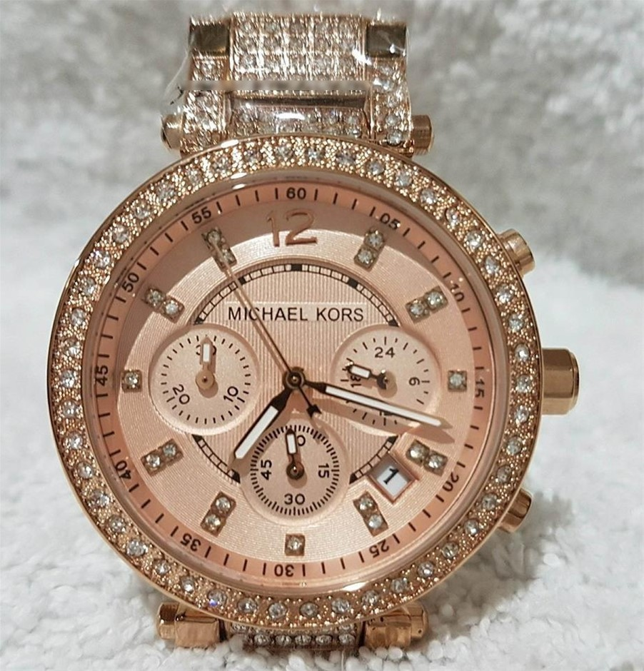 Ladies brand new Michael Kors Couture NY 'Parker' ladies rose chrono watch.