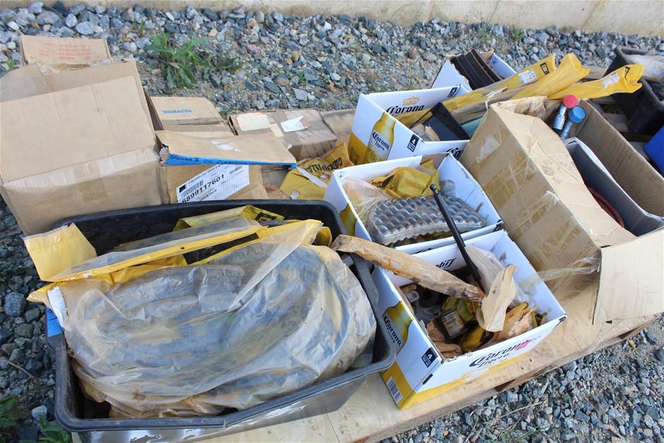 Pallet of Assorted Caterpillar, Komatsu, and Hitachi Parts