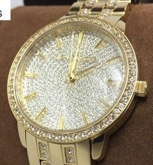 Ladies new Nini Pavé Gold Plated Michael Kors Couture NY watch.
