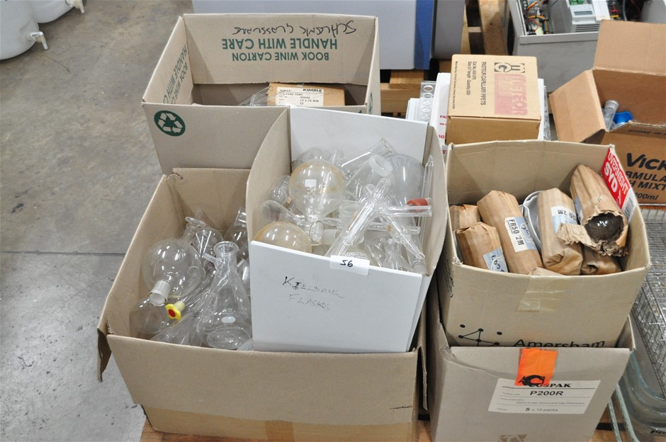Pallet of assorted laboratory glassware: Pasteur pipettes, conical flasks,