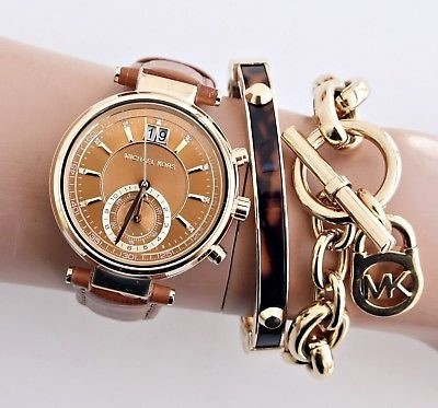 Ladies never worn Michael Kors Couture 'Sawyer' chronograph watch.