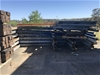Double sided cantilever rack for storing nominally 6m long,