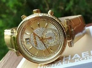 Ladies new glamorous Michael Kors Couture 'Sawyer' chronograph watch.