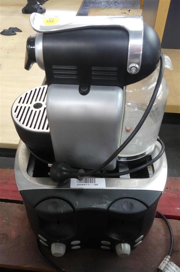 1 X Delonghi Nespresso 19 Bar Coffee Machine And 1 X Adesso 4 Slice Toaster