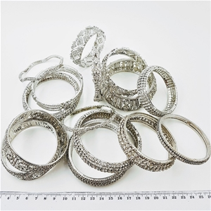 Collection Of 15 White Crystal Bangles.