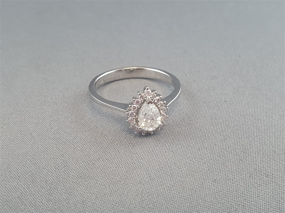 Stamped 18ct White Gold, 18 Diamond Cluster Ring