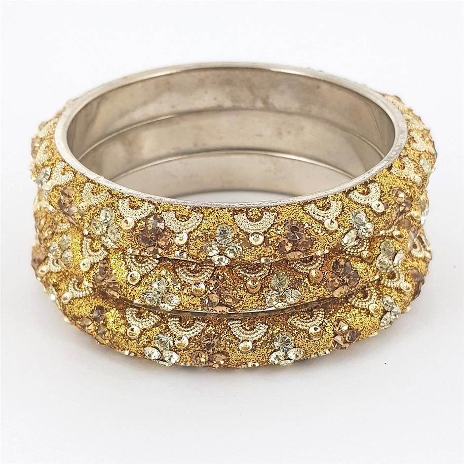 Three Gold & White Crystal Bangle Set.
