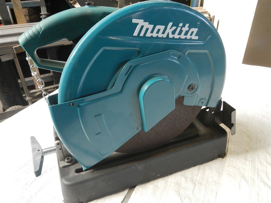 Makita drop saw, 355mm blade, 240v, quick release clamp.