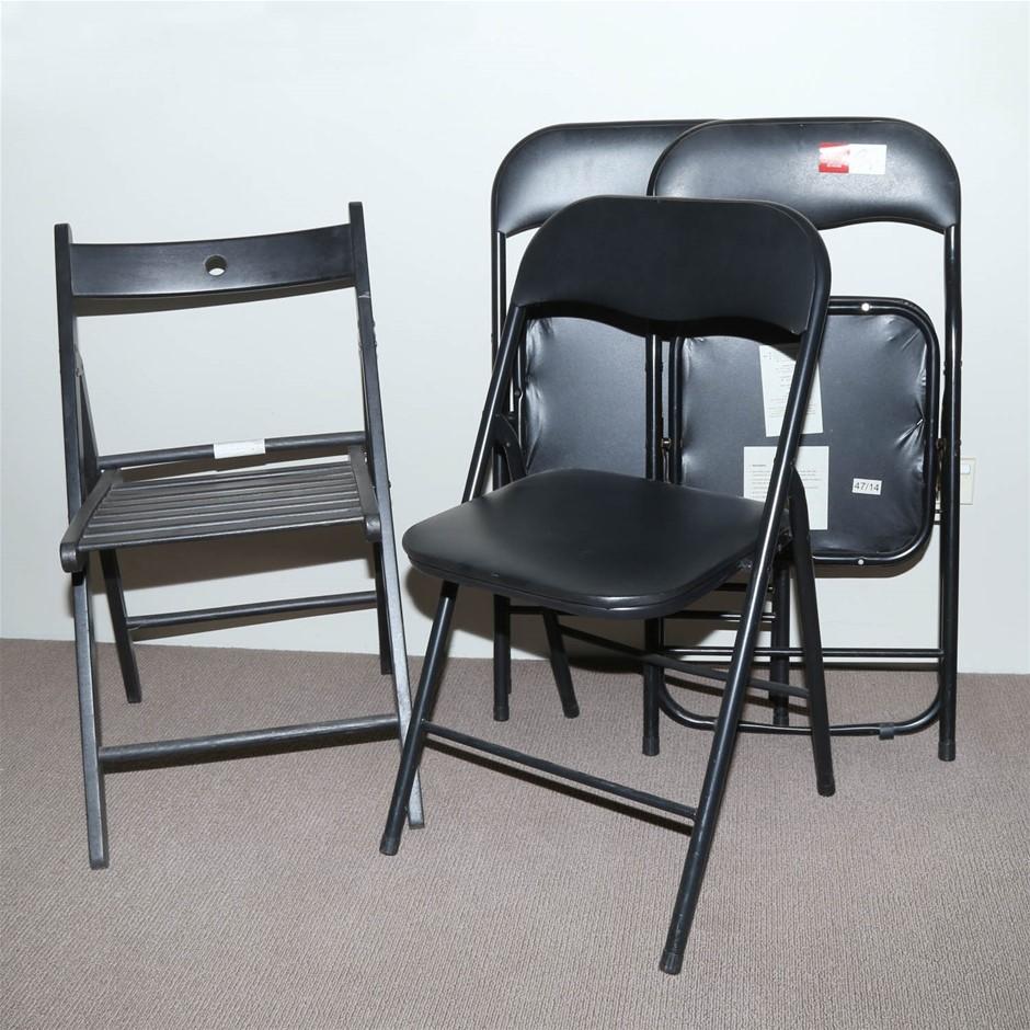 4 Fold-up Black Vinyl Chairs.