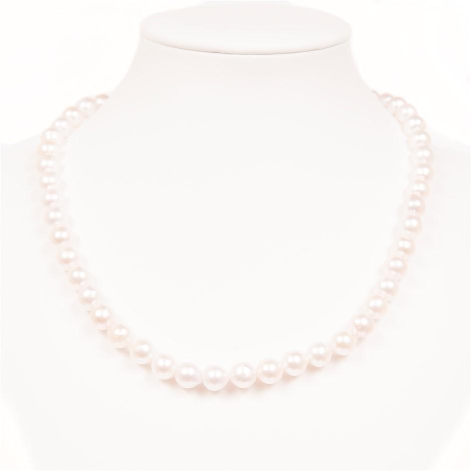 Lovely Single Strand Of Japanese Semi Baroque Akoya Pearls On White Silk.