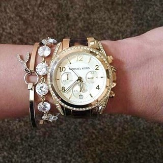 Brand new Michael Kors Couture NY 'Blair' ladies gold plated chrono watch.
