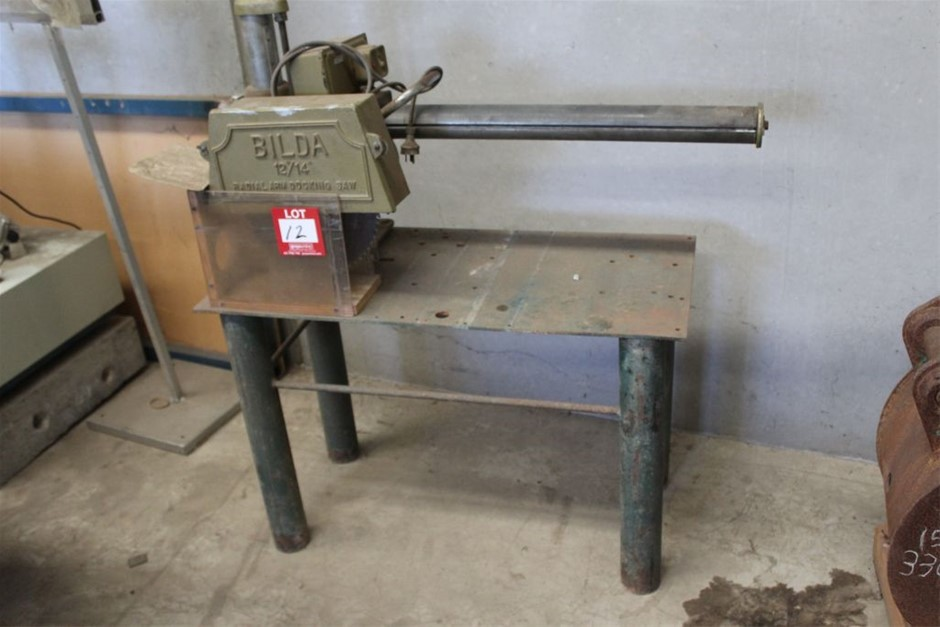 Bilda Radial Arm Docking Saw on Steel Stand