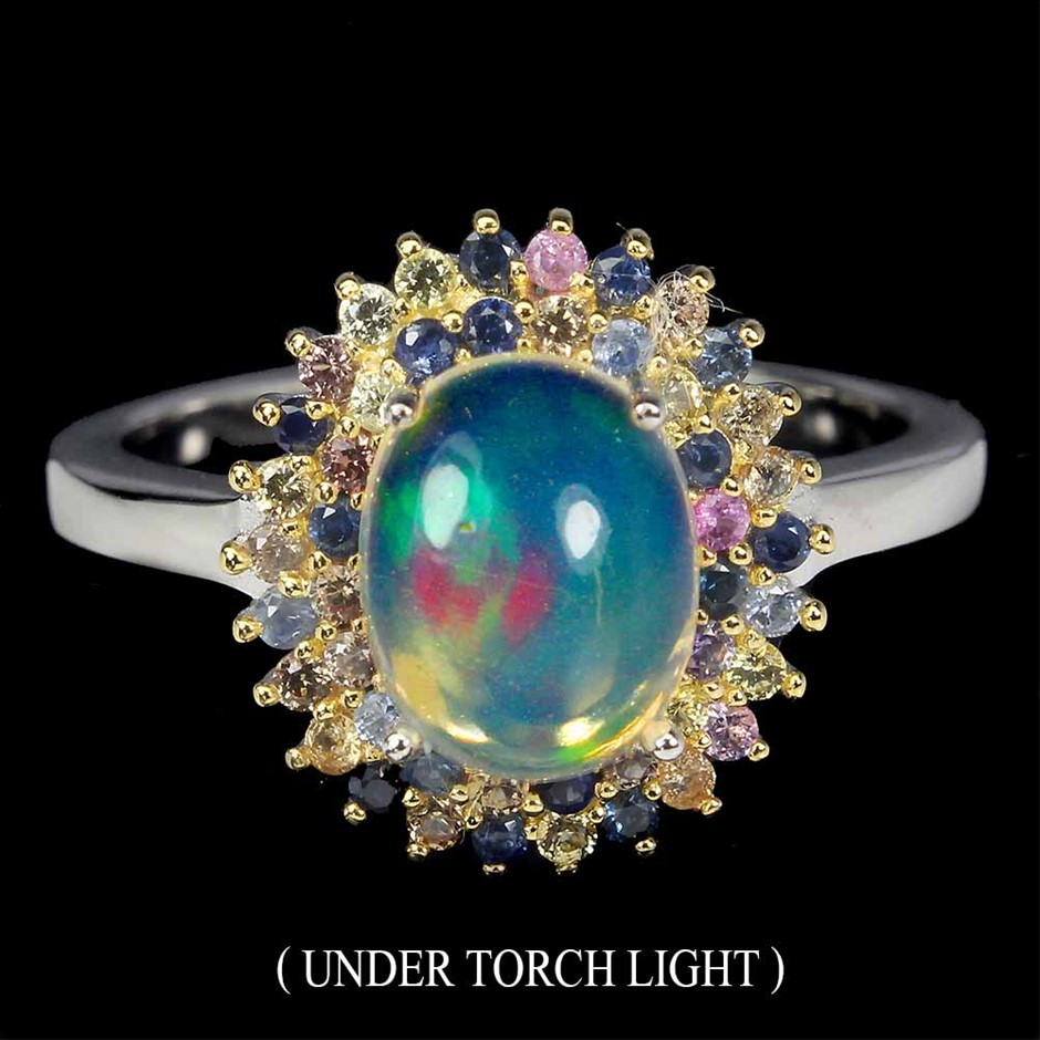 Striking Genuine Rainbow Fire Opal and Sapphire Ring.