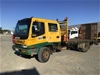<p>1997 Isuzu 8FX03 4 x 2 Tray Body Truck</p>